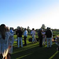 Oregon Coast Cocktail party.  Guest enjoy a beautiful evening on the 10th tee.